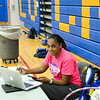 JOHN D'ONOFRIO/STAFF<br /> Lockport High School boys varsity volleyball coach Liz Smorol gets her computer files all ready to go for the coming season. The Lions held their first practice on Aug. 14 at the school.