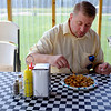 Joed Viera/Staff Photographer-YWCA Culinary Instructor Peter Flanagan tries out some poutine at KP Tuscorora Kitchens.