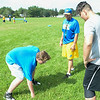 JOHN D'ONOFRIO/STAFF<br /> Lockport High School junior varsity football assistant coach Anthony Ventura, center, works with a couple of his linemen at the first official practice of the fall season on Aug. 14 at LHS. At left is Ashlar<br /> Kearns and at right is Geno VanDeMark.
