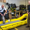 JOED VIERA/STAFF PHOTOGRAPHER-Vandemark Chemical's Environmental Health Saftey and Quality manager Chris Banach watches as Lockport Firefighter Luca Quagliano fills the LFD's new boat with an oxygen tank. The Chemical Company played a part in donating the inflatable boat to the department.