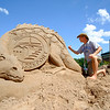 JOED VIERA/STAFF PHOTOGRAPHER-Lockport, NY-Todd Pangborn sculpts a dragon into the sands of the Riverie.
