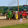 JOED VIERA/STAFF PHOTOGRAPHER-A Model A John Deere pulls the 45-ton sled down the track durin Cambria's Tractor Pull.