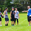 Lockport High School varsity football head coach Matt Vermette, right, talks to players at practice on Aug. 14 at LHS.