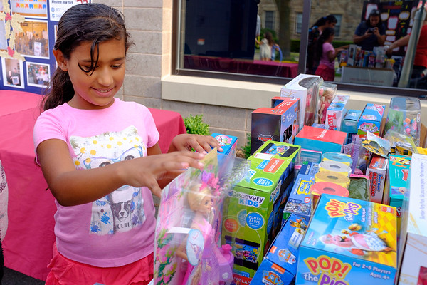 Joed Viera/Staff Photographer-Yazmin Acevedo 10, picks out a prize after winning tickets playing games during the Salvation Army's carnival Thursday evening.