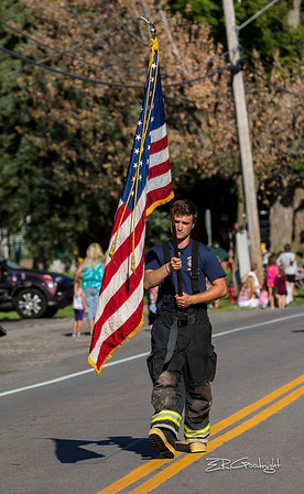 Ed Goodnight-A firefighter marches with Old Glory during Wilson's Field Days.