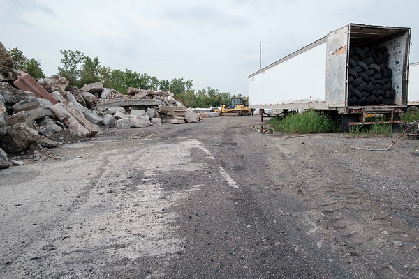 JOED VIERA/STAFF PHOTOGRAPHER-The remains of a building destroyed by the fire at HTI  last August lies in rubble by a trailer full of tires.