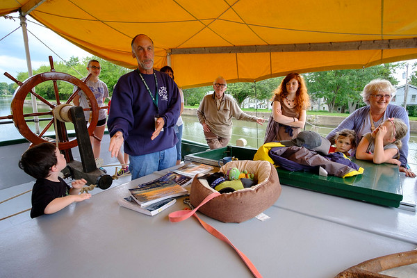 Dozens of people aboard the Lois McClure listen to Arthur Cohn speak about canal schooners during it's visit to Middleport, N.Y. on Wednesday, Aug. 23, 2017. The McClure, a replica that launched in 2004, was inspired by a shipwreck found at the bottom of Lake Champlain by students of Cohn.(Joed Viera/Lockport Union-Sun & Journal)