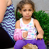 Joed Viera/Staff Photographer-Mariana Martinez, 3, eats popcorn during the Salvation Army's carnival Thursday evening.