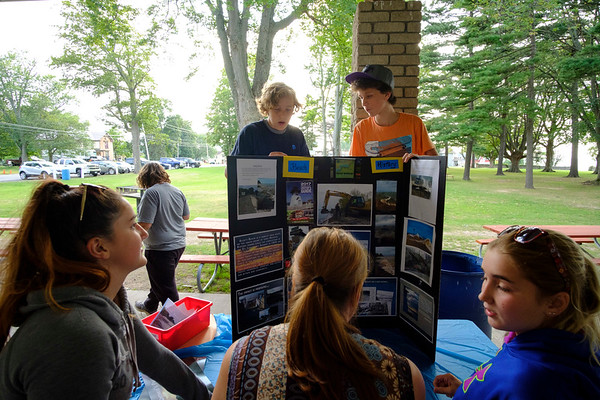 Joed Viera/Staff Photographer-Visitors check out the progress Newfane students have made on a summer school project presentation at Krull Park.