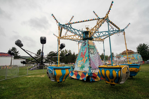 JOED VIERA/STAFF PHOTOGRAPHER-Rides are riderless as rain pours down during the Niagara County Fair.