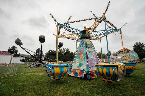 JOED VIERA/STAFF PHOTOGRAPHER-Rides are riderless as rain pours down during the Niagara County Fair.
