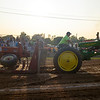 JOED VIERA/STAFF PHOTOGRAPHER-A John Deere's wheels spin in the dirt lifting its front as it struggles to pull a45-ton sled during Cambria's Tractor Pull.