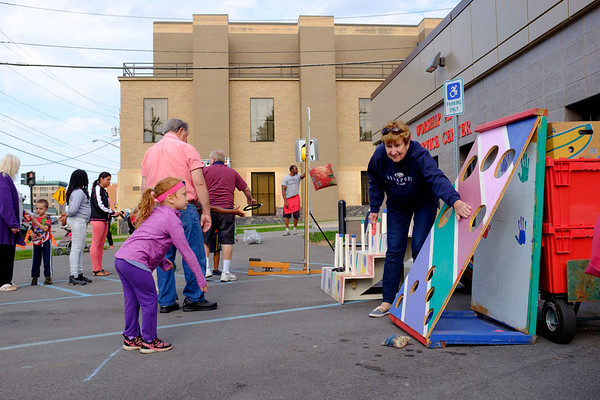Joed Viera/Staff Photographer-Madison Peyatt, 4, plays a game during the Salvation Army's carnival Thursday evening.