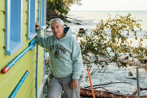 Joed Viera/Staff Photographer-Rich Flay by his Sunset Island  beach house on the Lake Ontario Shoreline.
