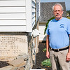 Joed Viera/Staff Photographer- <br /> Cambria Congregational Church pastor Todd Blackley stands by the Church's re-erected cornerstone.