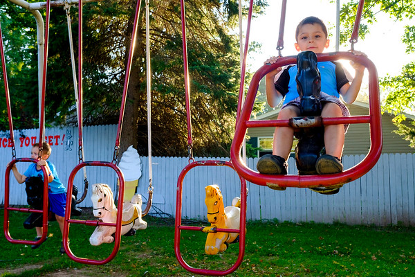 Joed Viera/Staff Photographer- Liam and Jameson Quirk, 4 and 6, hit up the swings at Widewaters Drive-In on the last full day of summer.
