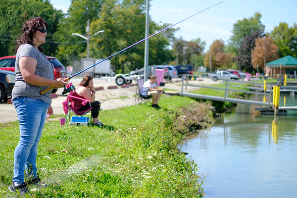Joed Viera/Staff Photographer- Tarra Hughes, Whitney Hughes and Joe Zemszal fish along the Canal near Nelson C. Goehle Marina.