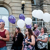 Joed Viera/Staff Photographer- <br /> Supporters hold violet and white balloons representing recovery and hope at an overdose victims remembrance outside the Niagara Count Courthouse.