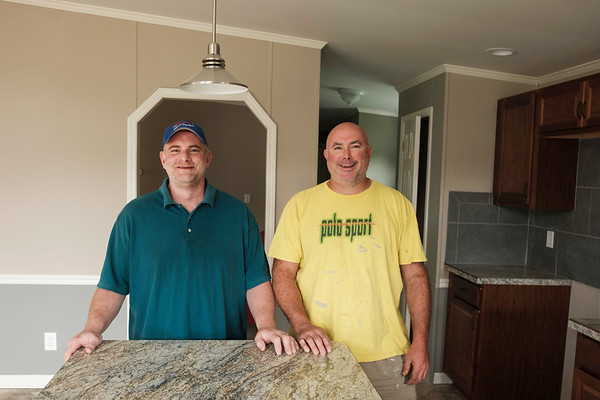 Joed Viera/Staff Photographer- <br /> Don Campanella and Mike Sidorski stand inside the home that will be raffled off in November to raise money for MS.