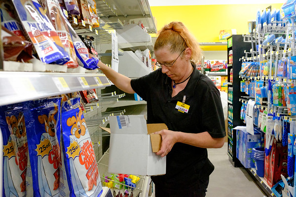 Joed Viera/Staff Photographer- <br /> Laura Jamieson-Williams stocks the   shelves at the Dollar General on Campbell Boulevard prior to it's grand opening.