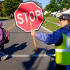 Joed Viera/Staff Photographer- Donofrio guides schoolchildren across Lincoln Avenue. Donofrio has been a city crossing guard for 50 years. Tuesday, Donofrio was suprised with flowers by Mayor Anne McCaffrey in celebration of her years of dedicated service.