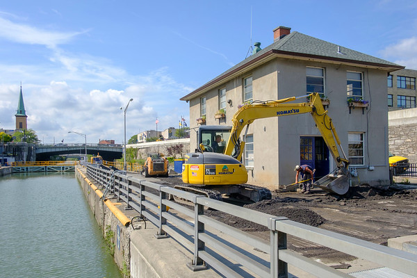 Joed Viera/Staff Photographer- An excavator digs between the barge canal and flight of five.