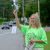Joed Viera/Staff Photographer- Chris Smith sells copies of the Union-Sun & Journal on the corner of Lake Avenue and Old Niagara Road for Make A Difference Day, the US7J's collaboration with the United Way.
