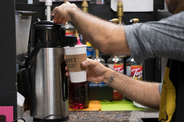 Joed Viera/Staff Photographer-Anthony Orta pours a cup of 1977 buffalo blend.