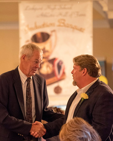 Joed Viera/Staff Photographer-Former Lockport Basketball Coach and current Hall of Famer<br /> Dick Crossett congratulates Brad Brunne on his induction into the Lockport High School Hall of Fame before a ceremony at Lockport Town & Country Club. Other inductees this year were Theresa Dolan-Mahar, Bob Verity, Kevin Haynes, Ryan Rimmer, Judy Pauley, Mark Russell, Carrie White and Scott Finn.