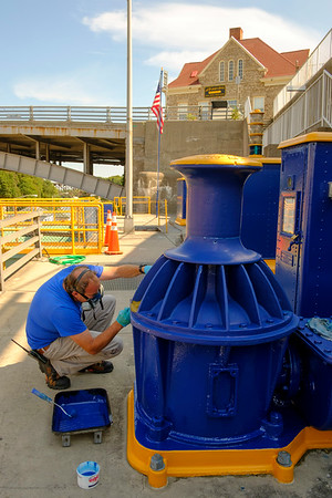 Joed Viera/Staff Photographer- John McKee, chief lock operator for Locks 34 and 35 paints a capstan at the locks.  Capstans are winches of sorts pulling unpowered crafts through the barge canal.