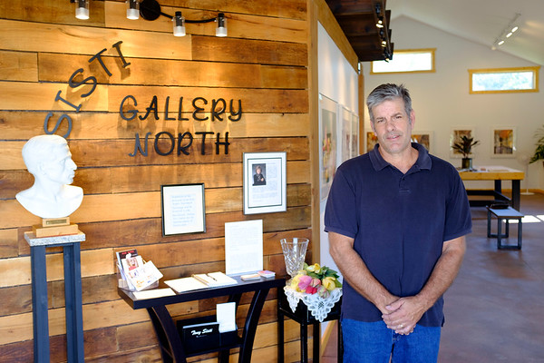 Joed Viera/Staff Photographer- Sisti Gallery North Owner Ron LaRocque said he was honored to have Auerbachs work featured in his gallery.