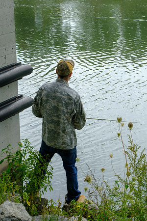 Joed Viera/Staff Photographer-Mike Jones fishes along the Canal.