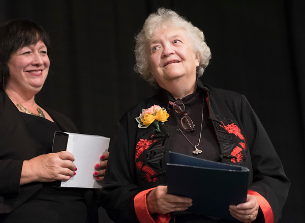 Joed Viera/Staff Photographer-YWCA of The Niagara Frontier CEO Kathy Granchelli, left, looks on after delivering a lifetime achievement award to Marjorie Gillies during the YWCA's 2017 Niagara Awards.