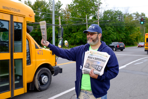 Joed Viera/Staff Photographer- Jose Santiago sells copies of the Union-Sun & Journal on the corner of Lake Avenue and Old Niagara Road for Make A Difference Day, the US7J's collaboration with the United Way.