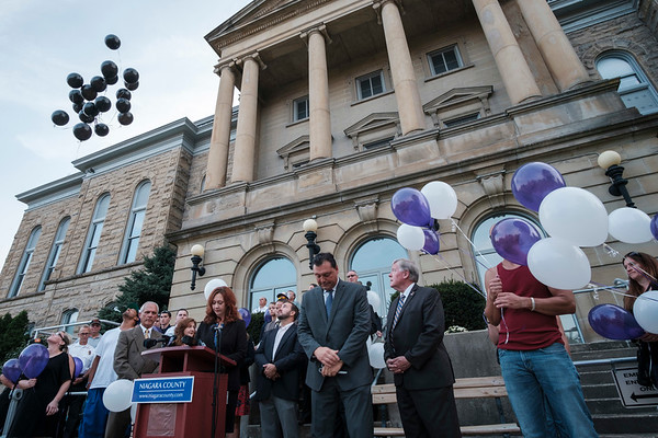 Joed Viera/Staff Photographer- <br /> Black balloons representing 20 Niagara County overdose deaths are released during an overdose victims remembrance outside of the Niagara County Courthouse