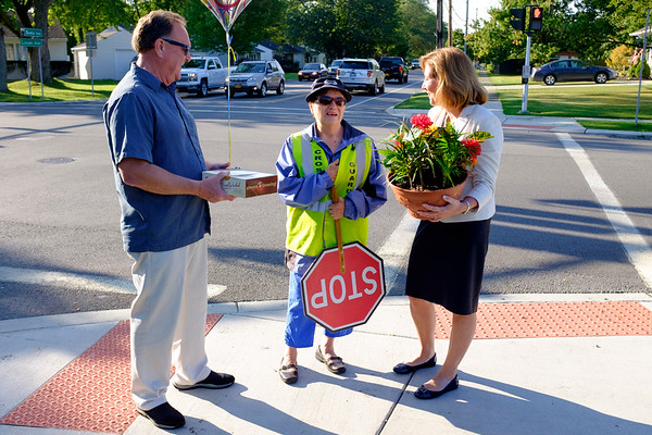 Joed Viera/Staff Photographer- Tuesday, Donofrio was suprised with flowers by Mayor Anne McCaffrey and Alderman Rick Abbott in celebration of her years of dedicated service. Donofrio has been a city crossing guard for 50 years.