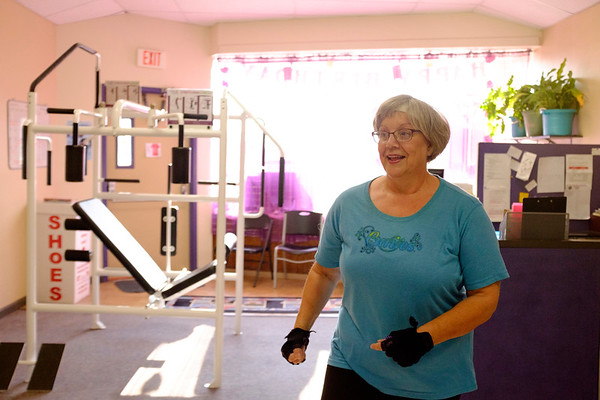 Joed Viera/Staff Photographer-Melody Masters  exercises at Curves.