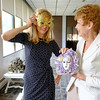 Joed Viera/Staff Photographer- Karen D'Angelo and Marion Hannigan try on Venetian masquerade masks.