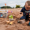 Joed Viera/Staff Photographer-Brody Christy, 3, plays with a toy dinosaur in the sands of the Riverie Beach.