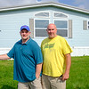 Joed Viera/Staff Photographer- <br /> Don Campanella and Mike Sidorski stand outside the home that will be raffled off in November to raise money for MS.