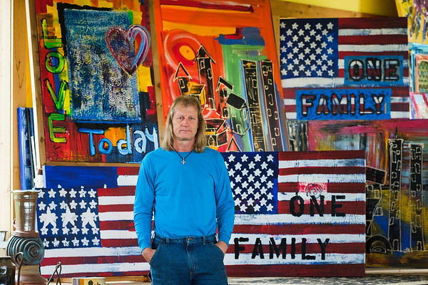 Joed Viera/Staff Photographer- Richard S. Manning in his studio. The paintings behind Manning are some of the over 1800 paintings created in memorial of 9/11. Manning has pledged to create 3,000 pieces total.