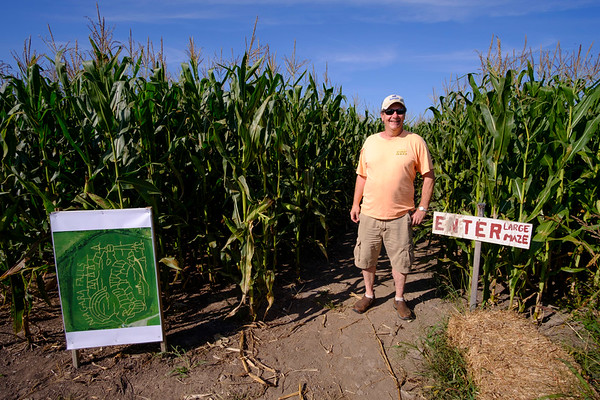 Joed Viera/Staff Photographer-Operator Jamie Kuminski by the entrance to the Cabria Corn Maze.