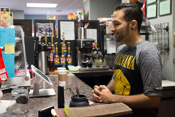 Joed Viera/Staff Photographer-Anthony Orta speaks to a customer at pulp 716.