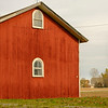 Joed Viera/Staff Photographer-A smokestack from the coal plant stands tall by a barn behind the Babcock House Museum
