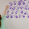 Joed Viera/Staff Photographer-A Royalton Middle School fifth grader is the latest to take a pledge to accept Rachel's Challenge by adding her hand print to the School's hallways. over 1,300 royalton students have accepted the challenge since the program was brought to the school 9 years ago.