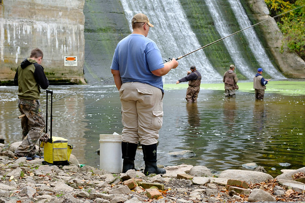 Joed Viera/Staff Photographer-<br /> Anglers Gianni Etopio 13 and Aaron Woods cast their rods into Eighteen Mile Creek at Fishermans Park.