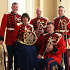 Trumpet players Master Sgt. Matthew Harding and Gunnery Sgt. Michael Mergen, French horn player Gunnery Sgt. Hilary Hart, trombonist Gunnery Sgt. Chris Clark, and tuna player Gunnery Sgt. Christopher Tiedeman have performed as a Marine Band brass quintet since the early 2000s. (U.S. Marine Corps photo by Gunnery Sgt. Kristin Mergen/released)