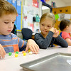 Joed Viera/Staff Photographer- Mackenzie Newman, 5, right, watches as Anderson Sarcharski, 5, builds a house to protect a pig from the big bad wolf with gumdrops and toothpicks inside of Kristin Andrews Kindergarten class at Newfane Elementary School during a Stem Event.