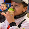 Joed Viera/Staff Photographer-George Southard Elementary School Kindergartener and astronaut Cameron McCoy enjoys a cupcake before the School's annual Halloween Parade.