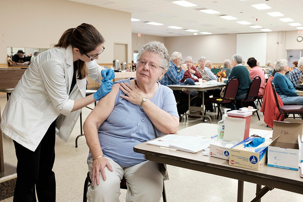 Joed Viera/Staff Photographer- Middleport Health Center pharmacist resident Amanda Zelinski gives a flu shot to Janet Meyer during the Barker Seniors Club's meeting at the Barker Volunteer Fire Hall. The influenza vaccine, available at most pharmacies, can keep you from getting flu, make flu less severe and keep you from spreading the flu. It takes around 2 weeks for protection to delvelop after vaccination. Influenza season usually runs between October and May.